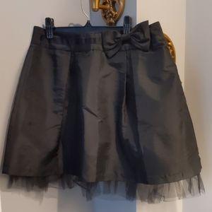 Black miniskirt with bow
